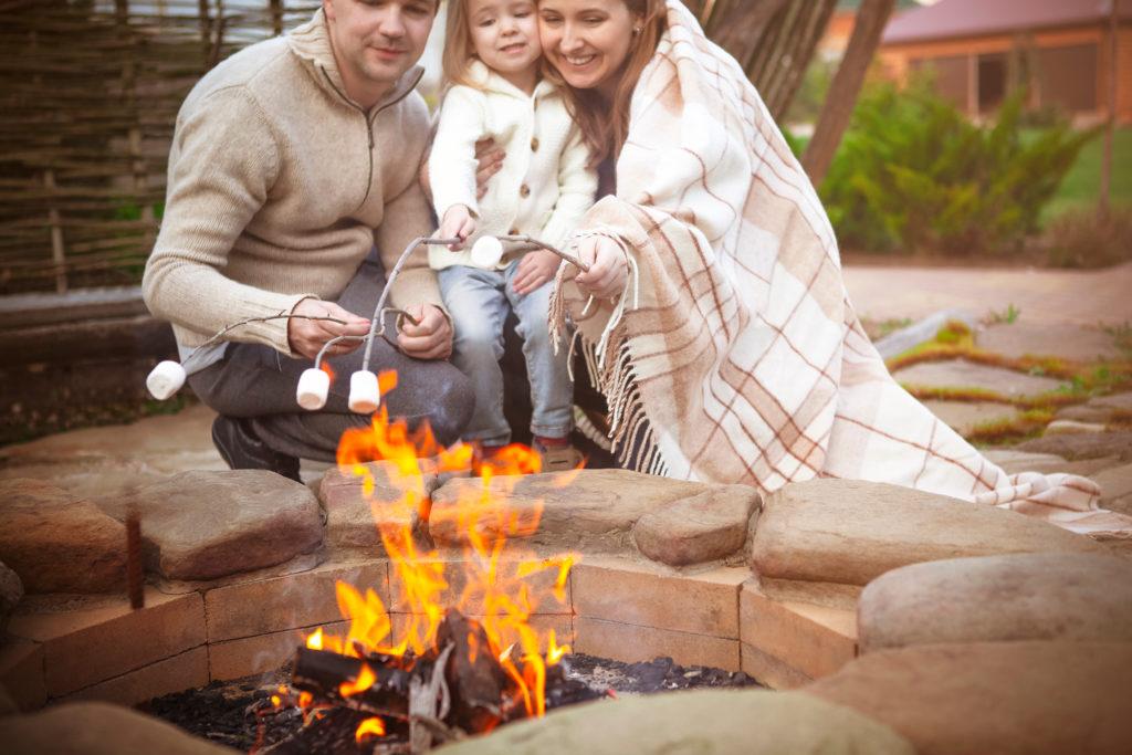 Family enjoying a bonfire together